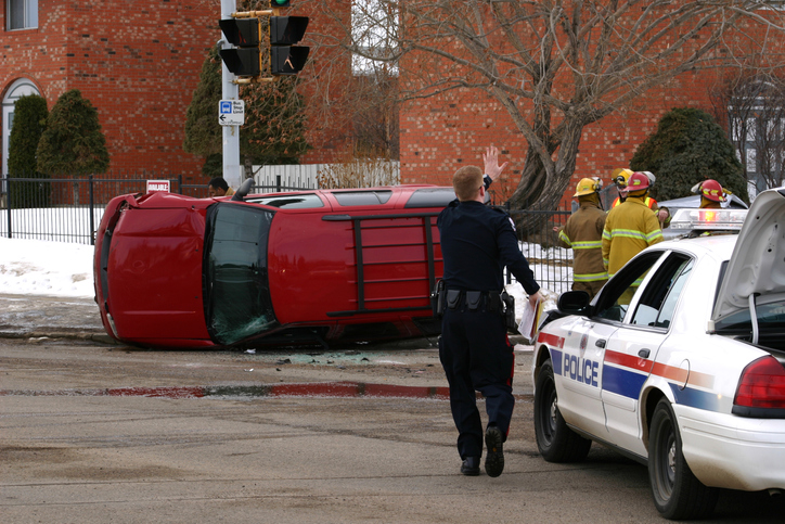 Emergency personnel attending to a rollover accident.